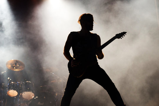 silhouette of a a guitarist on stage