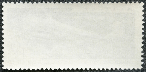 Blank postage stamp on a black background
