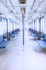 Empty corridor inside commuter train