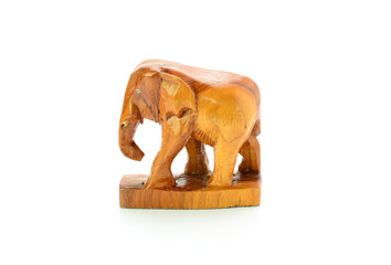 Hand-carving of an elephant ion front of a white background