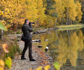 Photographer, taking pictures in fall season
