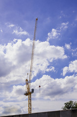 Cranes high external structure and sky.