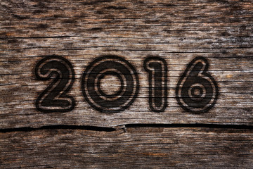 New year 2016 burning number in the old cracked wood with grunge look