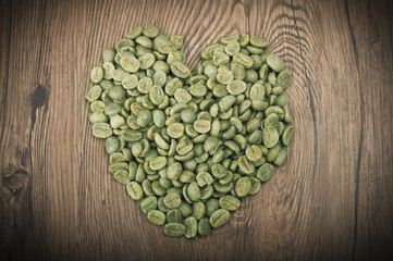 Wall Mural - Heart made from coffee seeds on the wood