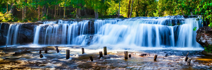 Stores photo Cascade Tropical waterfall in jungle with motion blur