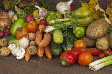 Various types of vegetables on an old wooden table. The concept of diet food. Food for obese patients. Autumn harvest vegetables. Growing fresh home-grown vegetables.