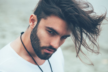 Photo sur Plexiglas Salon de coiffure Portrait of a man with beard and modern hairstyle