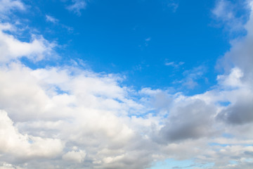 low gray and white clouds in blue sky