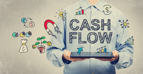 Cash Flow concept with young man holding a tablet