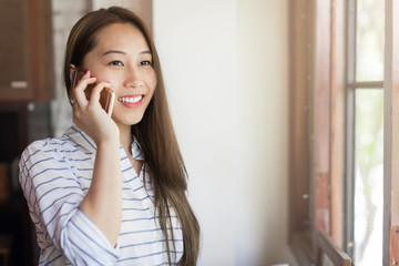 Asian woman cell phone call smile talking