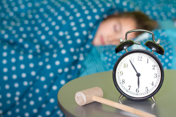 Morning waking up the problem with the alarm clock and hammer concept