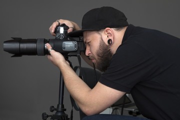 photographer taking pictures in the studio with gray walls