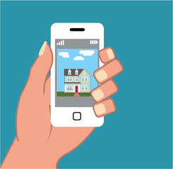 Smartphone in hand with house picture Vector