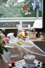 Romantic room settings with candles, glass vases and other decor