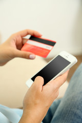 Female using mobile banking, close up