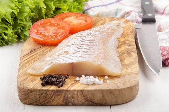 haddock fillet on a wooden board