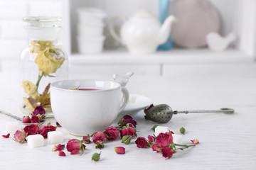 Tea set and rose tea on table