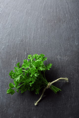 Fresh parsley on dark grey background