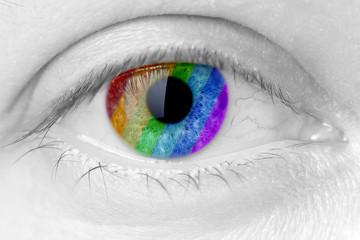 rainbow colours in a woman eye