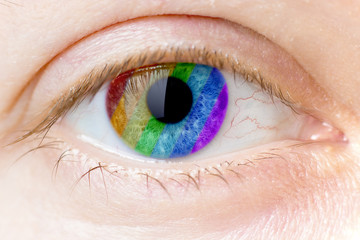 rainbow colours in a woman eye