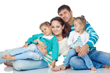 Happy family with kids in studio, white background
