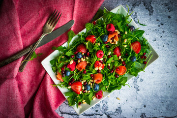 Wall Mural - Healthy salad with arugula,spinach,smoked salmon and berries