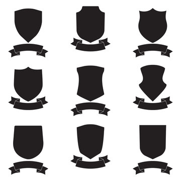 Shields and stylish ribbon set. Different black shield shapes collection. Heraldic royal design.