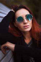Beautiful red hair woman in sunglasses