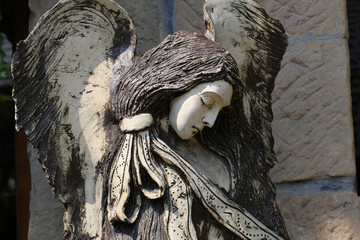 Carved wooden statue of angel