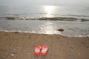 Coloured flip-flops on he beach
