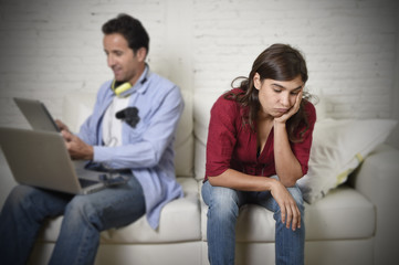 woman bored and frustrated ignored while internet addict husband or boyfriend using digital tablet networking
