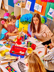 Children with teacher in  kindergarten .