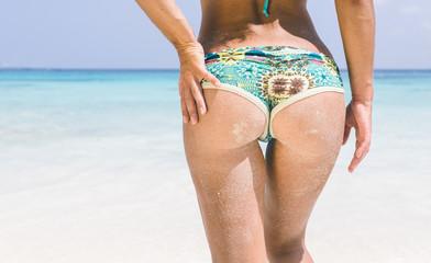 Beautiful woman body on a tropical beach