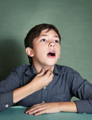 boy make singing exercises in blue background