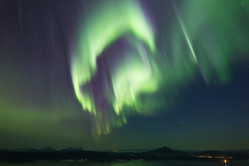 powerful aurora across star sky