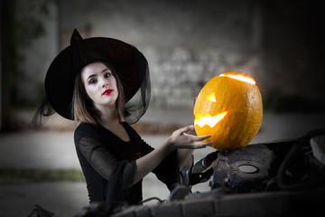 Witch casting her spells with pumpkin