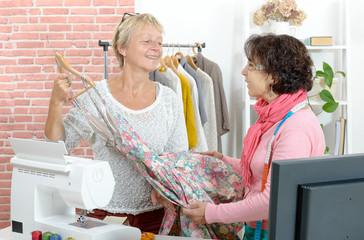 two seamstress looks a nice dress