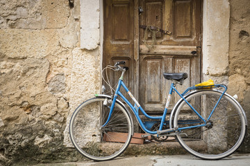 antique bicycle and an ancient wooden door