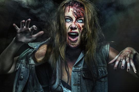 Close-up portrait of horrible zombie woman. Horror. Halloween.