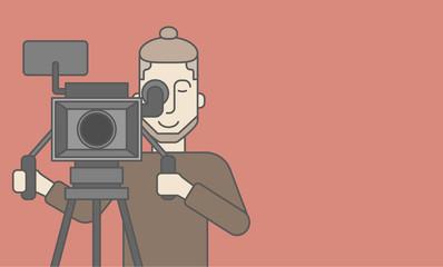Cameraman with beard looking through movie camera