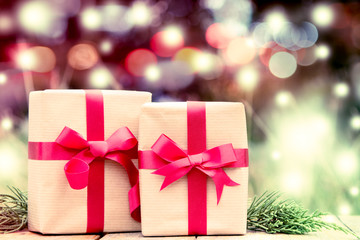 gift box with red bow on glitter bokeh background,vintage filter