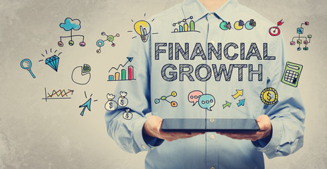 Financial Growth concept with young man holding a tablet