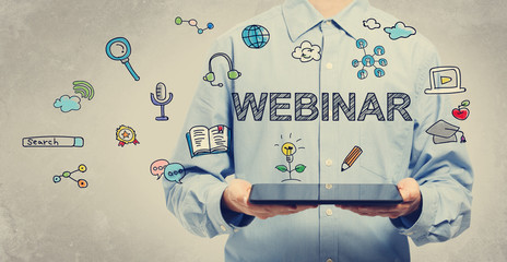 Webinar concept with young man holding a tablet