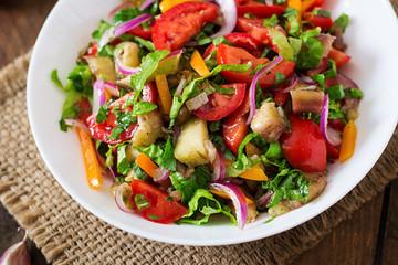 Salad baked eggplant and fresh tomatoes