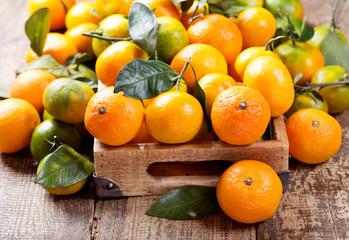 fresh mandarin oranges fruit  in wooden box