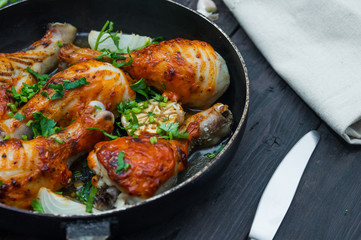fried chicken drumsticks in a frying pan