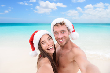 Christmas couple selfie picture on beach vacation