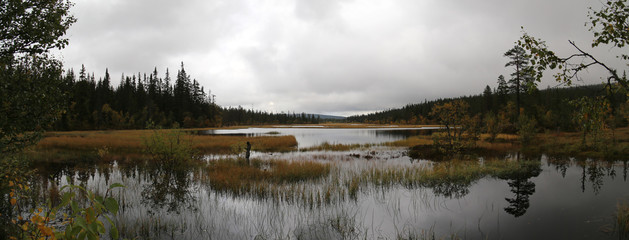 Panoramic view of Myrflodammen near Saelen, Sweden on a rainy september day