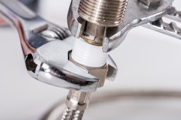 Plumber screwing plumbing fittings