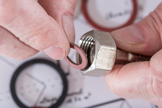 Plumber putting a gasket on a plumbing fitting